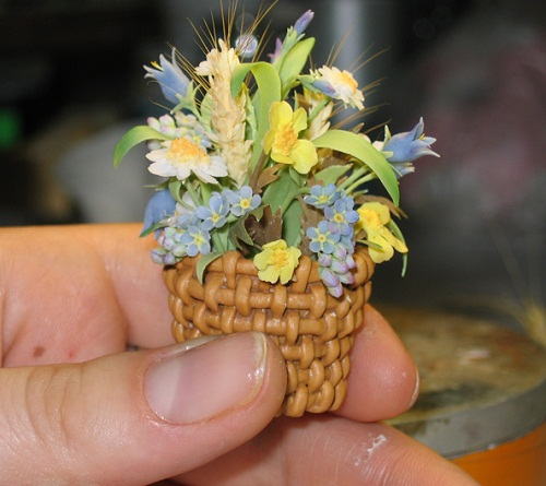 Miniature basket of flowers. Porcelain composition by creative group 'Lyudmila'