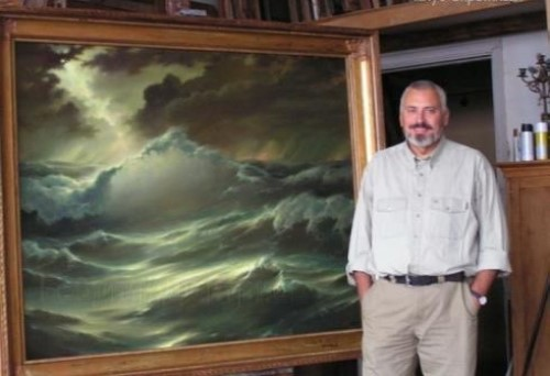 Russian artist Georgy Dmitriev next to his painting