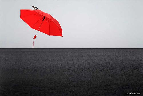 Minimalism genre. Red umbrella by Canadian photographer Andre Villeneuve