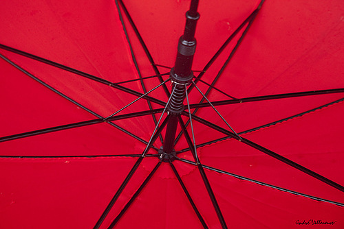 Closeup Red umbrella. Work by Canadian photographer Andre Villeneuve