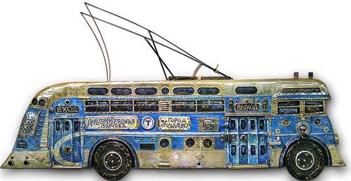 Steam punk art by Russian artist Alexey Stroganov. Blue trolley. Wood, metal, machine parts