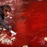 A girl taking water from the scarlet river in China