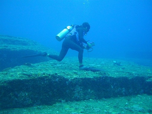Divers exploring the mysterious pyramids