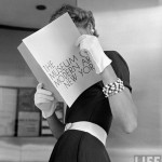 "Model with an album ""The museum of modern Art New York"" Life magazine cover. Photography by Nina Leen"