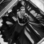 1949 photo of model wearing black chiffon skirt by Traina-Norell. Life. Photography by Nina Leen