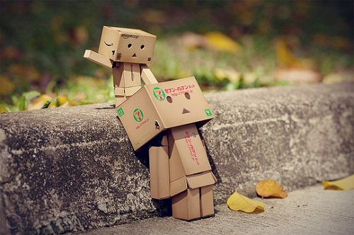 Emotional charismatic cardboard man, photography by Anton Tang
