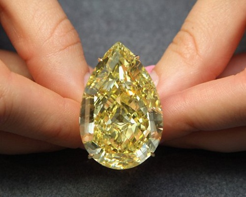 A Sotheby's employee holds a 110.03 carat sun-drop diamond on October 24, 2011 in London, England.