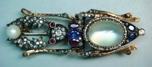 Brooch 'Beetle'. Gold, rubies, sapphires, diamonds, moonstone, pearl. Length of 8 cm. Faberge firm, Studio of Holstrem. Russia, St. Petersburg, before 1898