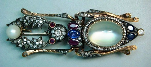 Brooch 'Beetle'. Gold, rubies, sapphires, diamonds, moonstone, pearl. Length of 8 cm. Faberge firm, Studio of Holstrem. Russia, St. Petersburg, before 1898