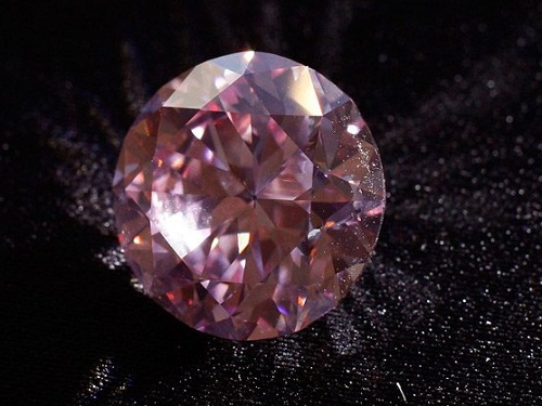 Extremely rare Martian Pink diamond,the largest ever to hit the auction market was sold for over double its original estimate for $17.4m through auction house Christie's.