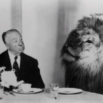 Sitting at the table Alfred Hitchcock with the MGM Lion