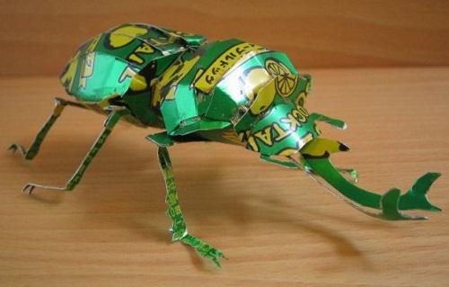 Scarab beetle. Aluminium can sculpture by Japanese artist Macaon
