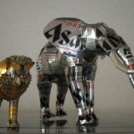 Elephant and lion. Aluminium can sculpture by Japanese artist Macaon