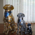 The family of dogs. Aluminium can sculpture by Japanese artist Macaon