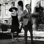Peppard and Hepburn walking down the street