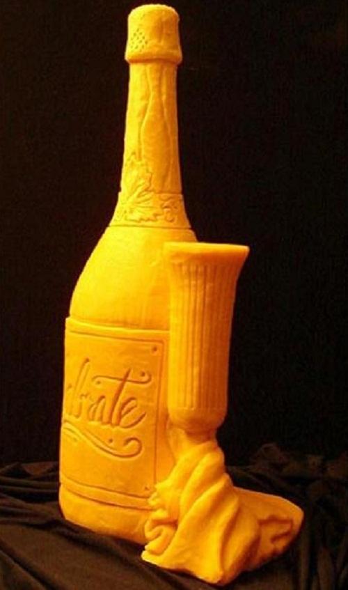 A bottle of wine. Creative cheese sculpture by American artist Sarah Kaufmann