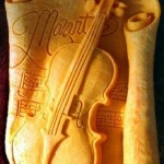Violin of Mozart. Creative cheese sculpture by American artist Sarah Kaufmann