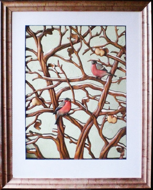 """December"" (Bullfinches), made of solid pine boards angora thickness of 20 mm in the author's technique – Obelets-intarsia. This is slotted bulk mosaic. Work as a kind of ""grid"", room wall (background) visible"