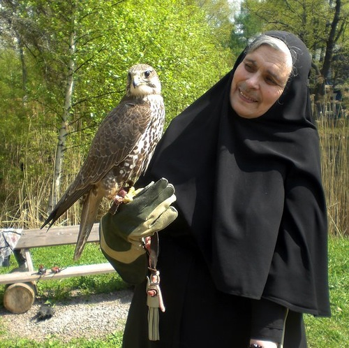 A nun with a falcon in her hand