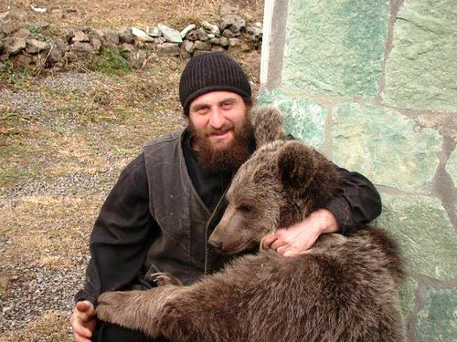 Hugging bear. Georgian orthodox Christians from the Ruisi-Urbnisi bishoprics