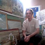 Russian artist Grigory Ksenew next to his paintings