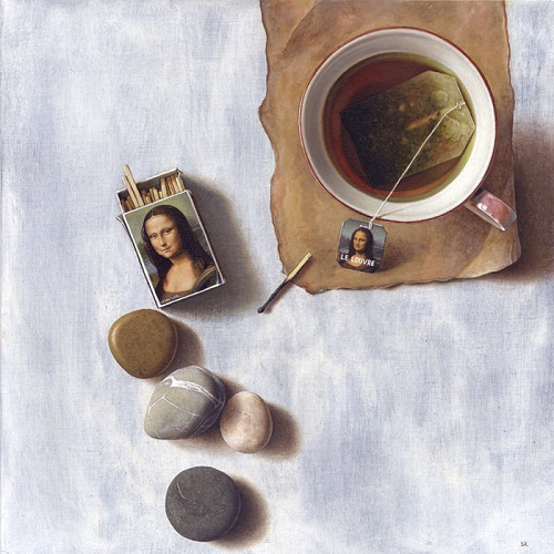 Pebbles, matches and a tea cup