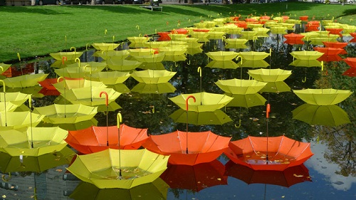 Colorful installation of umbrellas by Luke Jerram