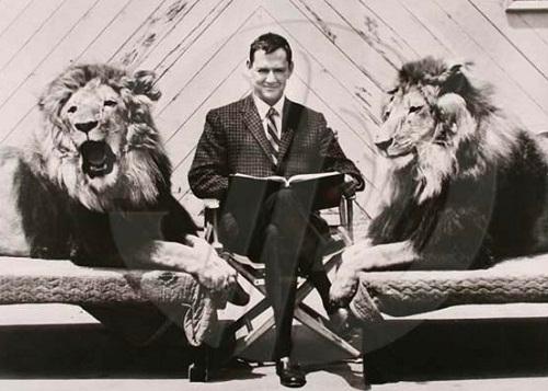 In between, director William Watson with Metro-Goldwyn-Mayer lion