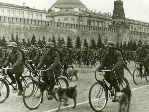 Military dog breeders on bicycles, parade May 1, 1938