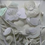 A bird among flowers. White Paper cut art by British artist Helen Musselwhite
