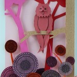 Colorful Paper Owl Town by British artist Helen Musselwhite