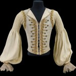 doublet for the role of Prince Florimond, Act III, in Sleeping Beauty, Teatro alla Scala, Milan, 1966. Sleeveless gray and silver waistcoat trimmed with gold lace, yellow braid, and gold filigree buttons; white false shirt with pleated sleeves and lace cuffs