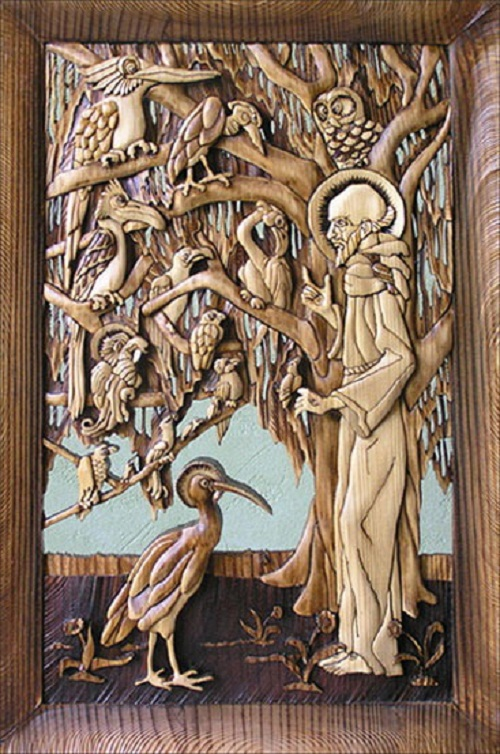 Saint Francis preaching to birds – a replica of genius Escher. Work performed in the author's technique – volume slotted mosaic monolithic pine boards