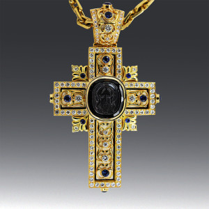 """The cross with the face of the Savior"". Stones: Cross on chain, Diamond, gold 750"