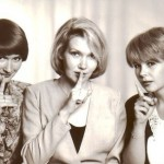 Putting fingers to their lips. Already in 1992. Three close female friends from Russia