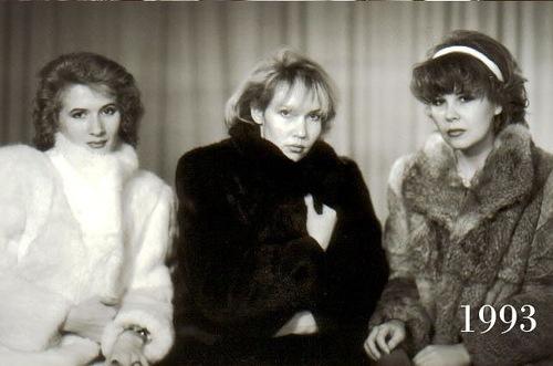 Wearing fur coats, winter photo of three best female friends, 1993