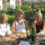2011 photo – sitting at the breakfast table. Three close female friends