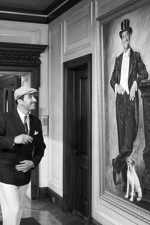 Looking at the portrait with Uggie
