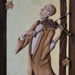 Violinist. Work performed in the author's technique – slotted bulk mosaic. Material – board of larch