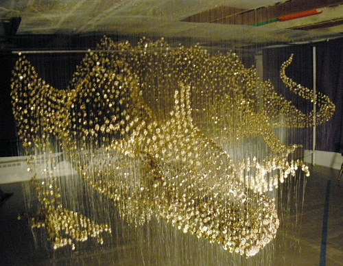 Impressive view of button sculpture of Golden dragon