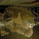 Holographic Button dragon by American artist Robin Protz