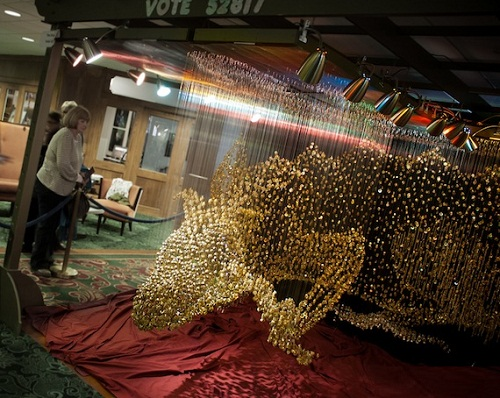 Large scale Golden dragon of buttons by American artist Robin Protz