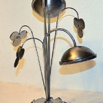 Flower of unfulfilled fantasies, metal composition by Russian artist and sculptor Sergey Malyugin