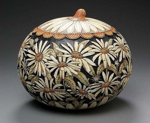 Camomile field. Pumpkin carving by American artist Marilyn Sunderland