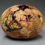 Butterfly and leaves, carved, pumpkin vase created by American artist Marilyn Sunderland
