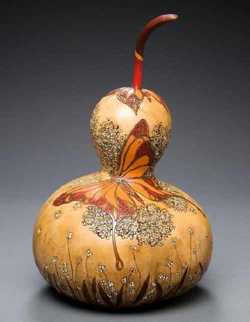 Pumpkin turned into beautiful work of art. Delicate pumpkin carving by American artist Marilyn Sunderland