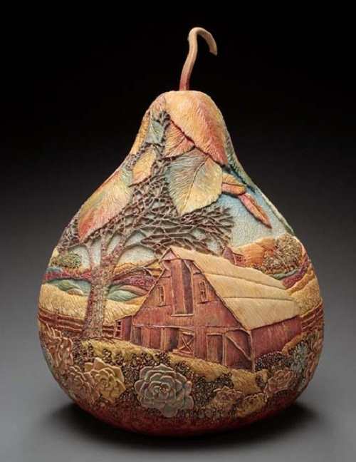 Village landscape, beautiful pumpkin carving by American artist Marilyn Sunderland