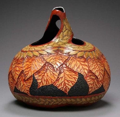 Basket of leaves. Delicate pumpkin carving by American artist Marilyn Sunderland