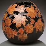 Stunning work of pumpkin carving – autumn leaves vase by Marilyn Sunderland