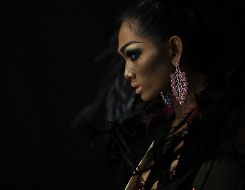 The participant from the Philippines named Jimenez, preparing to perform on stage during the contest of beauty